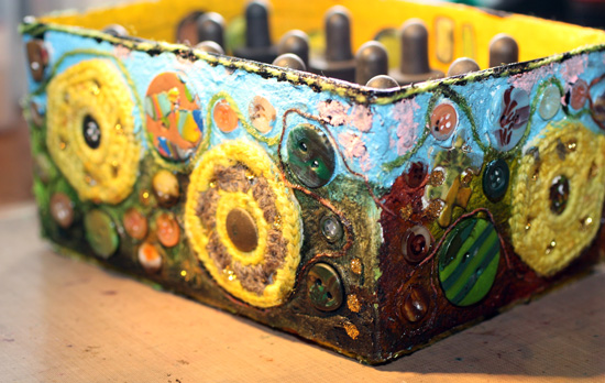A decorated box using mixed media, a closeup