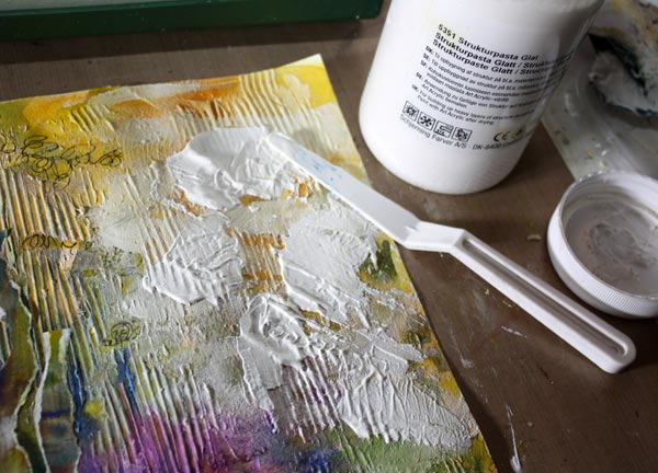 Creating a mixed media collage using molding paste