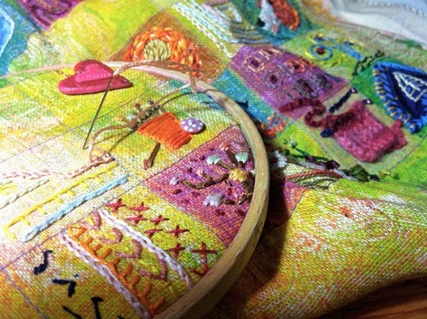 Stitching an embroidered sampler, by Peony and Parakeet