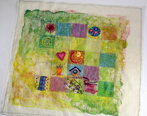 An embroidered sampler by Peony and Parakeet, a phase photo