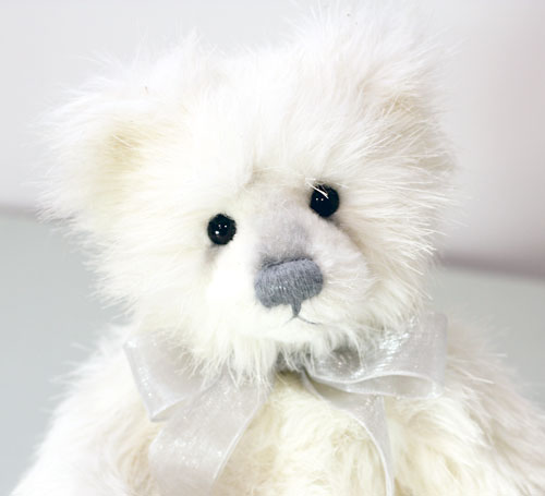 A white teddy bear, Niamh, manufactured by Charlie Bears