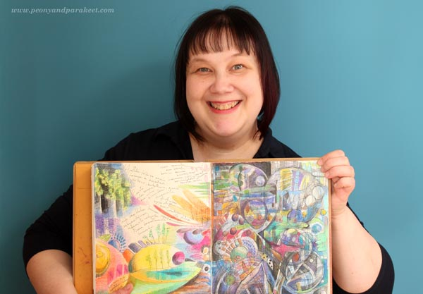 Paivi from Peony and Parakeet with an art journal spread colored with colored pencils