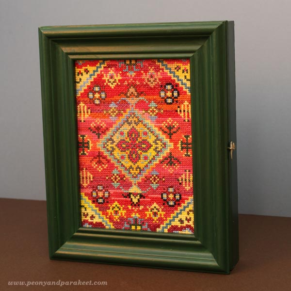 Key storage cabinet with a cross stitch cover using leftover flosses. By Peony and Parakeet.