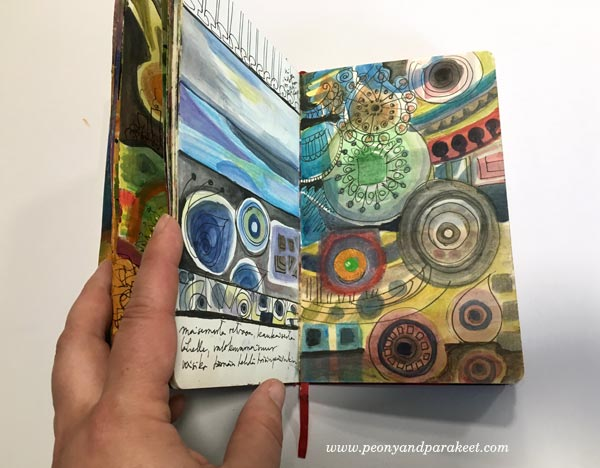 An art journal spread in a Moleskine Sketchbook. Browsing an art journal. By Peony and Parakeet.