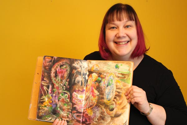 Paivi and Storyteller's Power, her mixed media drawing. Read more about expressing inspiration through art!
