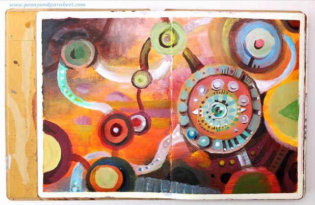 An art journal page spread by Paivi Eerola from Peony and Parakeet. She has a class called Planet Color for painting colorful abstracts!