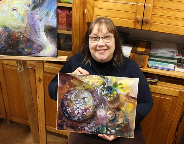 Paivi Eerola and her paintings.