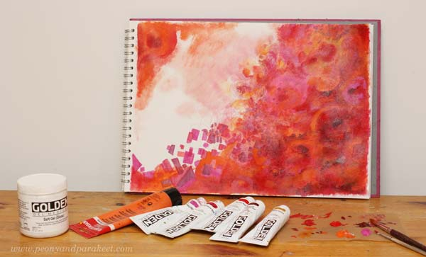 Painting a color-oriented art journal page. See the step-by-step directions on how to make and finish this mixed media art journal page!