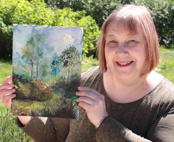 Paivi Eerola and her watercolor painting.