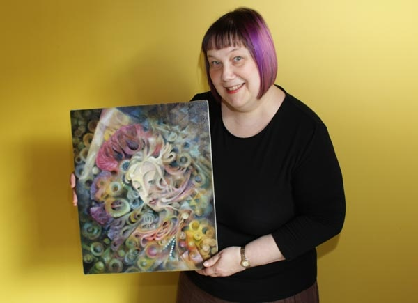 Paivi Eerola and her oil painting Heaven and Earth.