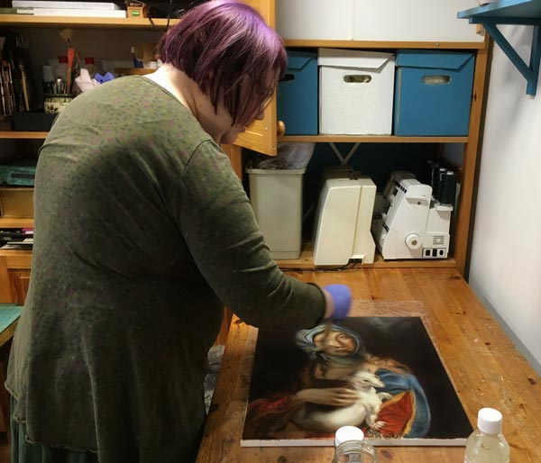 Varnishing an oil painting with Rublev Dammar Finishing Varnish. By Paivi Eerola from Peony and Parakeet, Finland.