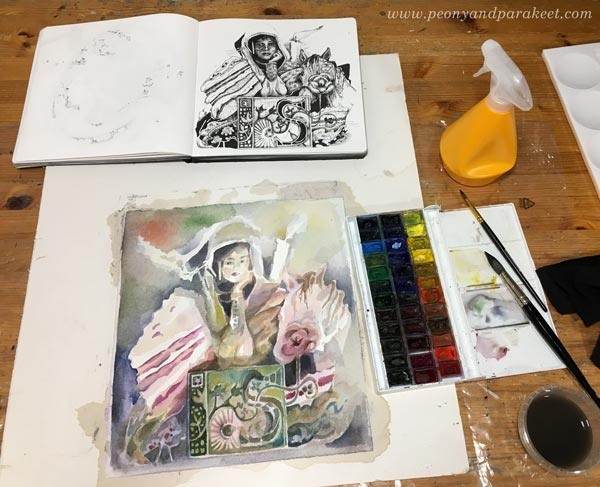 Creating a watercolor painting from an ink drawing. Using a sketchbook as an inspiration for watercolors. Watercolor painting in progress. By Paivi Eerola from Peony and Parakeet.