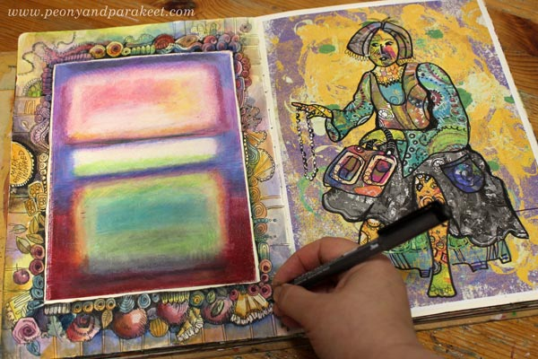 Drawing a decorative frame on an art journal. By Paivi Eerola of Peony and Parakeet.