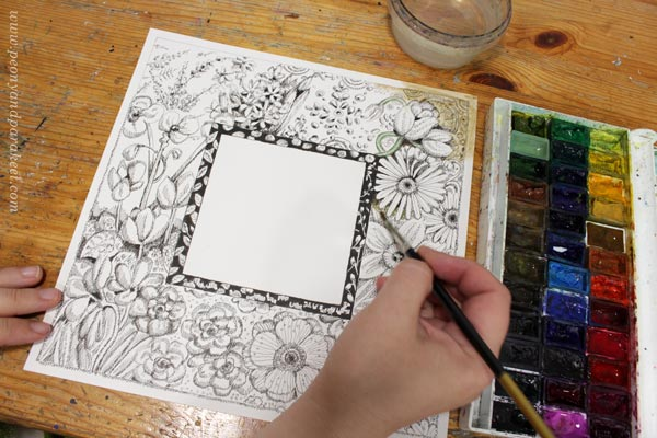 Coloring a decorative frame with watercolors. By Paivi Eerola of Peony and Parakeet.