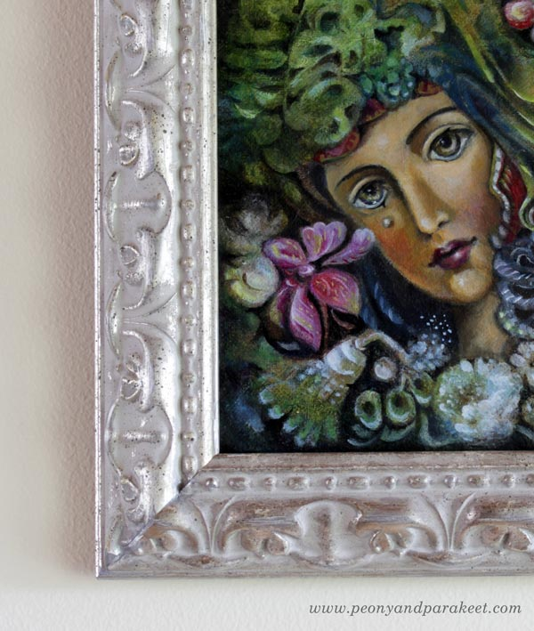 Framing art. A painting by Paivi Eerola of Peony and Parakeet.