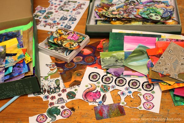 Boxes of hand-decorated papers by Paivi Eerola of Peony and Parakeet.