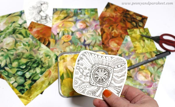 Decorating a tin box with beads, embroidery floss, and hand-drawn and hand-painted papers. Inspired by the tv series Sanditon. By Paivi Eerola of Peony and Parakeet.
