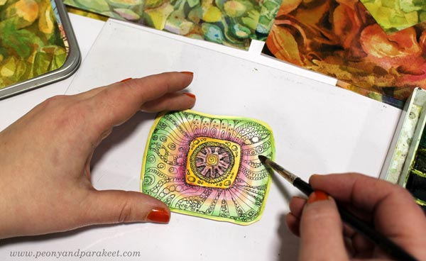Decorating a tin box with beads, embroidery floss, and hand-drawn and hand-painted papers. By Paivi Eerola of Peony and Parakeet.