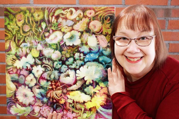 Artist Paivi Eerola of Peony and Parakeet and her oil painting in progress.