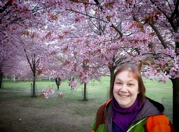 Paivi Eerola in a flowering cherry tree park.