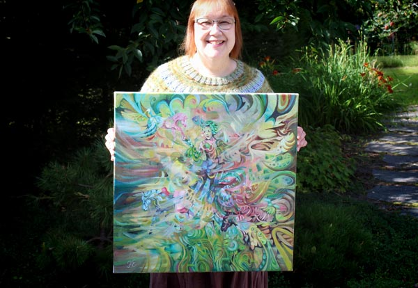 Paivi Eerola holding her painting Arotuuli / Steppe Wind.