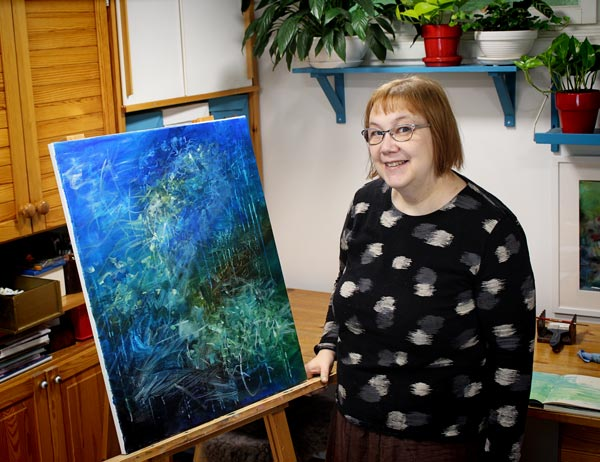 Artist Paivi Eerola and an abstract acrylic painting in progress. She helps artists to find clarity for their art.