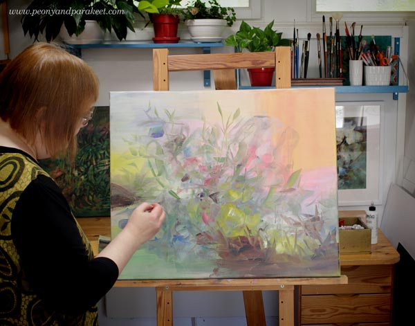 Artist Paivi Eerola and her painting in progress.
