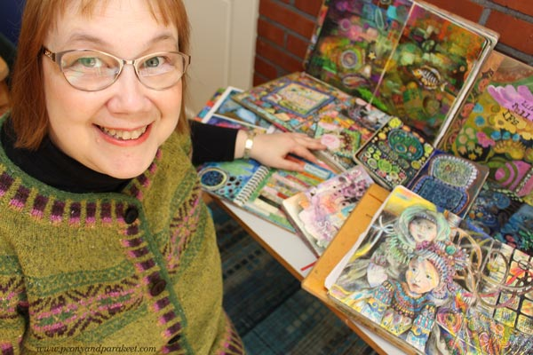 Paivi Eerola and her many art journals.