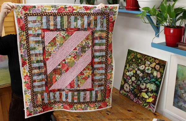 A dog quilt by Paivi Eerola of Peony and Parakeet. Read her thoughts about crating and art-making, craft artists, fine artists, and crafters.