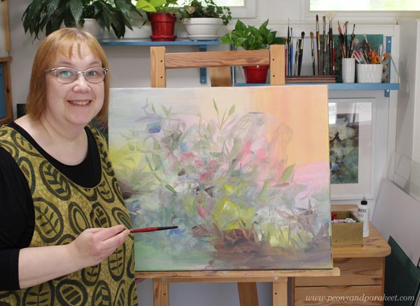 Paivi Eerola and her painting in progress.