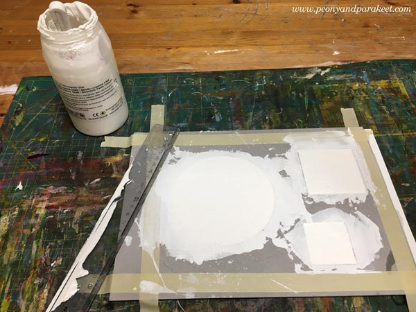 Filling cardboard templates with structure paste. Making reliefs for an acrylic painting.