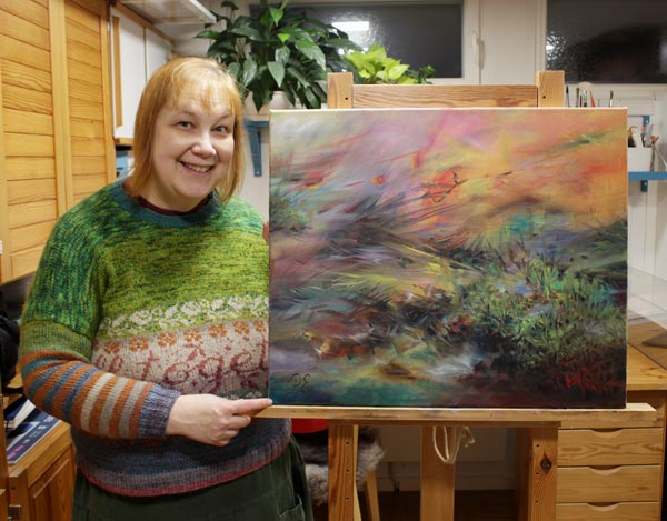 A Finnish artist Paivi Eerola and her painting.