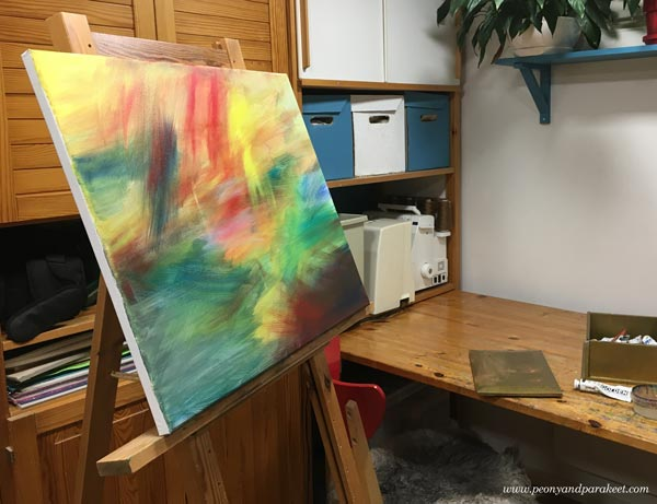 Starting an abstract landscape painting by Paivi Eerola of Peony and Parakeet
