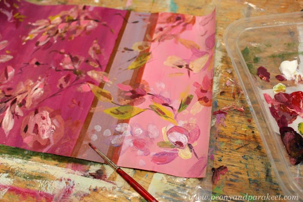 Adding details to a monoprint with a brush. By Paivi Eerola of Peony and Parakeet.