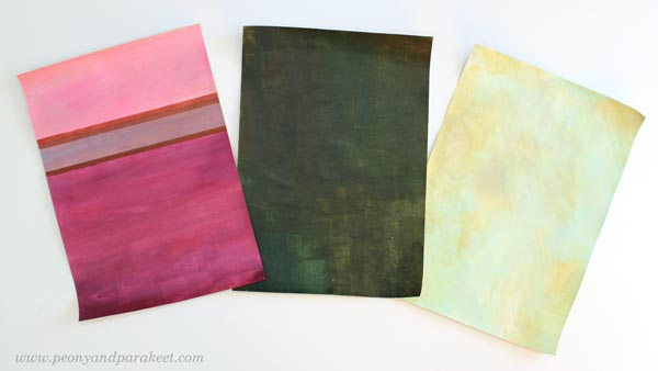 Three painted backgrounds. The backgrounds set a color palette for the papers.