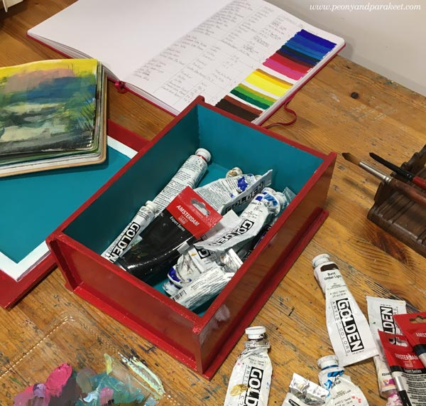 Acrylic paints, brushes, and a color chart. By Paivi Eerola of Peony and Parakeet.