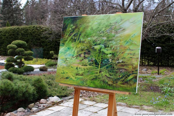 "Photographing a painting in the garden. Oil painting ""Unchanging"" by Paivi Eerola."