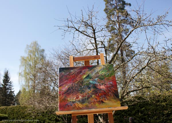 """""""Finch"""" - an oil painting by Paivi Eerola, photographed against the sky."""