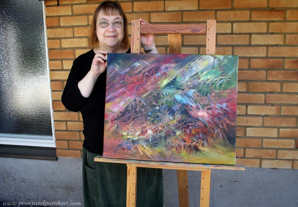 Paivi Eerola and her painting Finch. Read more about her red personality and what she thinks about Thomas Erikson's book Surrounded by Idiots.