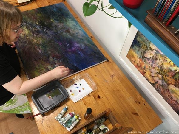 Paivi Eerola in her studio. A mystical painting in progress.