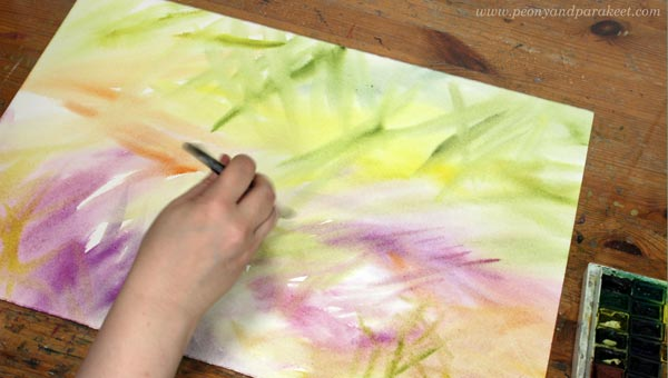 Starting a new watercolor painting. Getting over blank paper syndrome by using lots of colors and water.