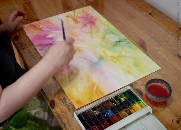 Working in a studio as a watercolor artist. Concentration is a part of artist's life.