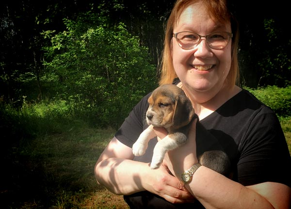 Paivi Eerola holding her new beagle puppy.
