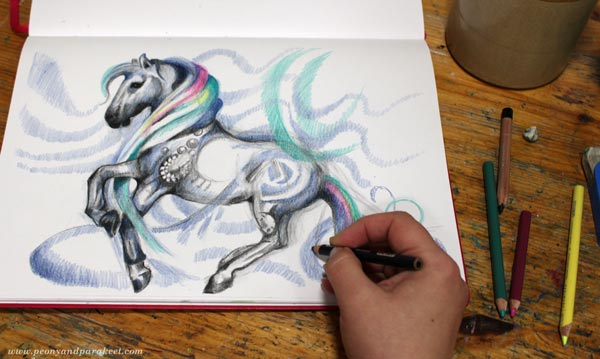 Drawing with colored pencils.