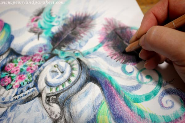 Coloring details with colored pencils.