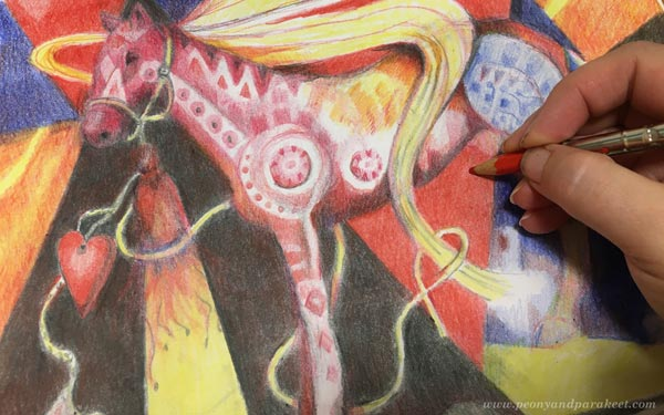 Drawing horses in colored pencils. Combining intentional and intuitive expression.