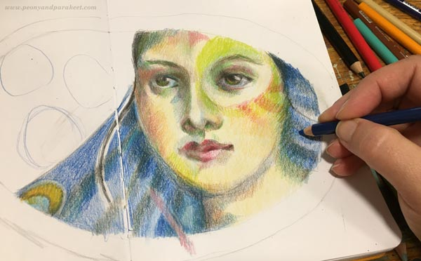 Making of a colored pencil diary. Drawing a face with colored pencils.