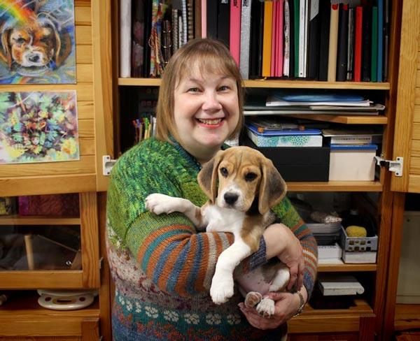 Paivi Eerola in her studio with her puppy Saima.
