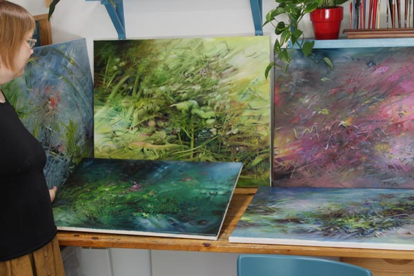 Paivi Eerola and her oil paintings.